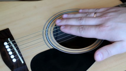 stroking the guitar