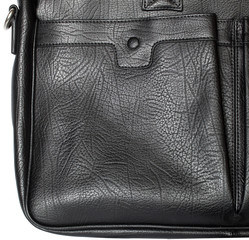 closeup black leather bag