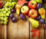 Organic Fruits over wood background. Autumn harvest