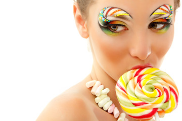 woman licks candy with beautiful make-up isolated on white