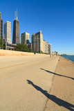 Jogger Shadows on Downtown Chicago Lakeshore Trail poster