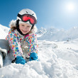Ski, snow and fun - happy skier playing in snow