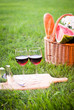 glass of red wine and picnic basket