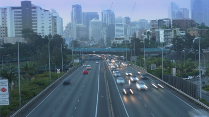 City freeway in timelapse. Day to night. (Zoom to CBD)