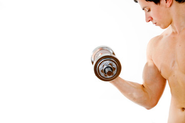 Powerful muscular young man lifting weights against white backgr