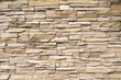 Leinwandbild Motiv Stacked stone wall background horizontal