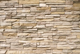 Fototapety Stacked stone wall background horizontal