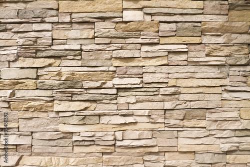 Brogujący kamiennej ściany tło horyzontalny