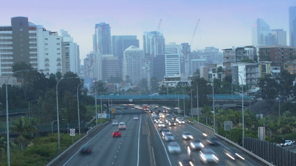 City freeway in timelapse. Day to night. (Zoom from CBD)