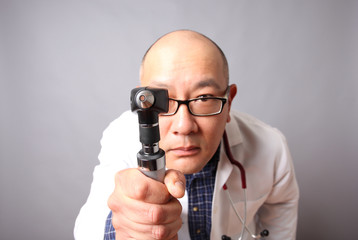 Doctor with an otoscope