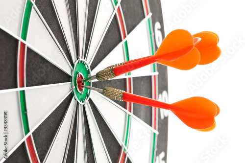Darts hitting the bullseye