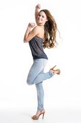 Happy girl in jeans posing at studio