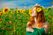 Red-haired woman with sunflowers