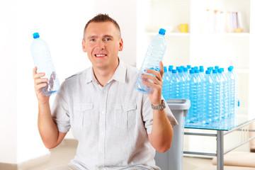 Man Holding Plastic Bottles