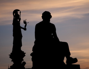 Vienna - silhouette of philosopher statue and Athena funtain