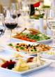 Leinwandbild Motiv Different snacks for wine on banquet table