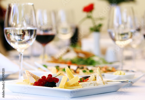 Different snacks for wine on banquet table