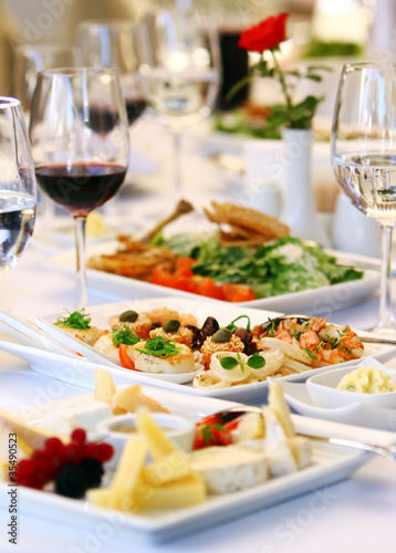 Canvas Assortiment Different snacks for wine on banquet table