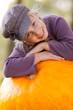 girl with huge pumpkin autumn