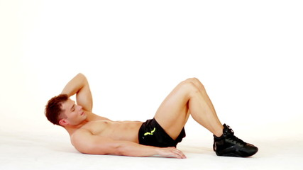 Handsome muscular man exercising on white background