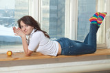 sexy girl sits on a window-sill poster