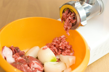 meat through a meat grinder for force meat