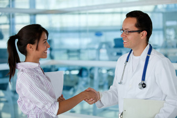 Insurance agent with a doctor handshaking