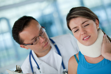 Injured woman with a physiotherapist