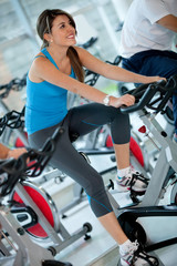 Woman doing spinning at the gym