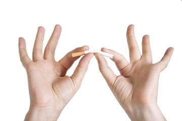 Man's hands breaking a cigarette
