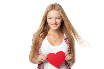 Blond female with fluttering hair holding heart shape