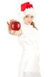 Santa female cook in white uniform and Christmas hat with apple