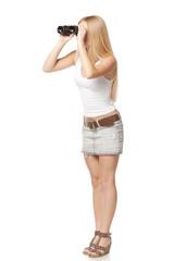 Full length of blond woman looking through binoculars