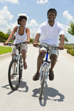 African American Adult Man and Woman Couple Cycling