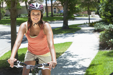 Young African American Woman Riding Bike