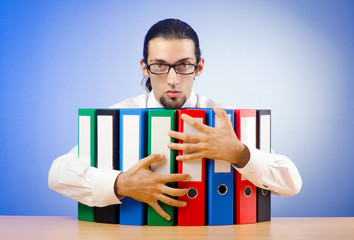 Businessman with many office folders