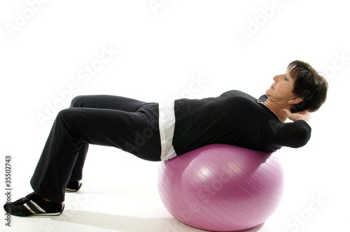 woman using core training fitness ball for abdominal crunch sit-