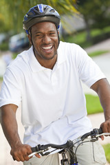 Happy African American Man Riding Bike Smiling