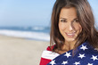 Young Woman Wrapped in American Flag Towel on a Beach