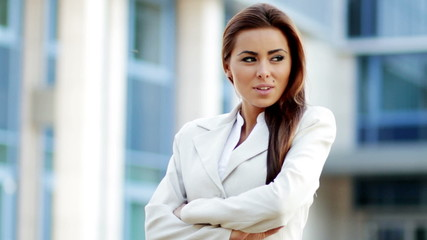 Attractive business woman outside office building