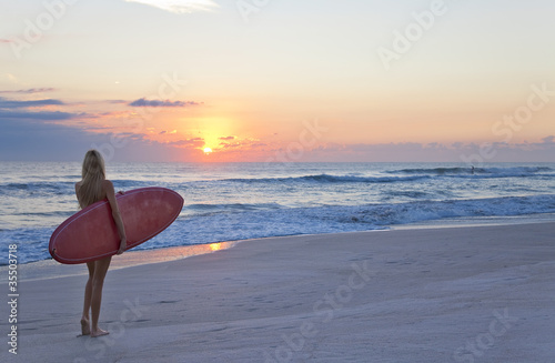 Beautiful Woman Surfer With Surfboard At Sunset Sunrise Beach