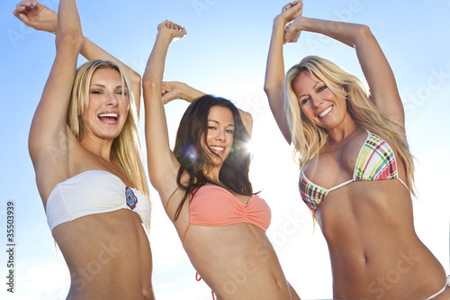 Three Beautiful Women In Bikinis Dancing on Sunny Beach