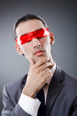 Businessman blinded by red tape