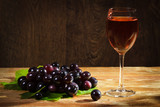 Red grapes with glass of wine