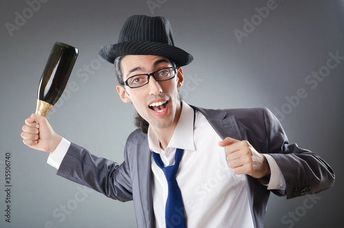 Businessman with bottle of champagne