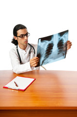Male doctor looking at x-ray image