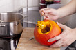 cooking hokkaido pumpkin soup in a modern kitchen.