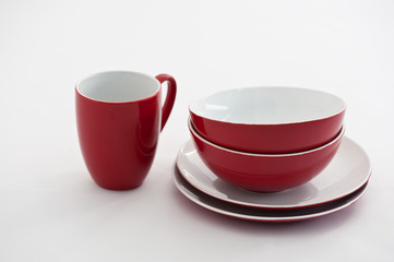 Red and white plates and bowls