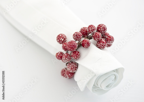 White napkin with xmas berry napking ring