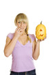 Attractive woman with a pumpkin for Halloween